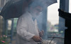 Barbecue (Jeremy Caney) Tags: atmospheric britishcolumbia canada chef cooking dngimport dinner drab granvilleisland gray grill grilling meat monochromatic rain reception ribs smoke spring takenbyjeremy tomandcarrieswedding umbrella vancouver vancouverbc wedding weddings weddingscarrietom