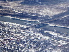 A barge on the Illinois River (yooperann) Tags: illinois river barge boat bridge snow aerial photo grain elevators