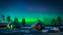 two huts illuminated by the northern lights (Juhwie_Fotography) Tags: hut cottage snow winter frost northern lights aurora trees lake stars nightshoot nightscape landscape landscapephotography nature magical light green pentax pentaxart ricohimaging k1 1530 ngc finland finnland finlandia scandinavia saija