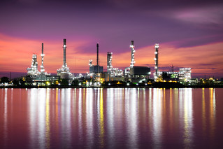 Petrochemical plant area in morning with reflection in river