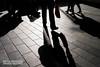 Red bag (wanderandclick) Tags: shadow england streetphoto street people streetphotography fujifilm red contrast silhouette candid light reflection fujifilmx100f liverpool fujifilmx walking europe pavement city unitedkingdom gb