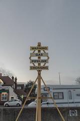Gas Crossing (John Pettigrew) Tags: d750 nikon sunset van mundane warning man urban boring pub imanoot motorhome banal sign yellow johnpettigrew suburban