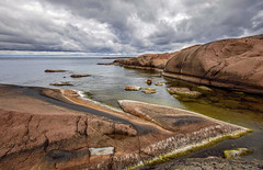 Havsvidden, Geta, Åland, Europe (Marc Arnoud Rogier van der Wiel) Tags: sky bay rock rocks stone cliff water waterfront shore shoreline sea seaside seascape baltic exposure weather nature europe åland geta havsvidden cloud clouds horizon lighthouse outdoor serene grass design pattern formation photo