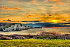 Seven Sisters (Croydon Clicker) Tags: dawn sunrise daybreak sunset cliffs sea hills ocean bushes grass sky clouds glow radiant morning seascape landscape 500v20f 1000v40f
