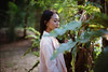 Emerald Forest (Jon Siegel) Tags: nikon nikkor fe2 film nikonfilmcamera woman forest beautiful trees afternoon filmphotography iso800 expiredfilm 50mm 50mmf12 50mm12 ais 50mmf12ais singapore singaporean