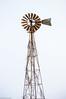 Windmill (cowgirljo78) Tags: windmill old rusty tall winter abstract nikon d3200 metal fins fan generator vines vintage tarnish