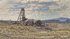 Tailings (magnetic_red) Tags: mine gold abandoned equipment decay derrick buildings sky clouds desert sand dirt tailings mining nevada americanwest