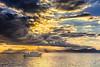 Sol silenciado (Juan Sastre) Tags: agua mar costa mediterraneo mallorca canon sol nubes barco embarcacion barca rayos cielo montaña