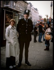 Wife and PC Hinks at Picadilly Circus, 1977. (iEagle2) Tags: woman wife analog analogfilm analogue autumn ehefrau england ektachrome streetphotography policeman posing female femme frau film hinks policeconstaple vinestreet piccadillycircus london londonstreet 1977 october seventies