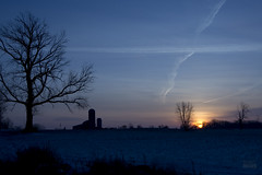 SunriseSurreyRdMichiganBDMCart1 (Sandi Beaudoin) Tags: michigan mi clare white balance kelvincolors red blue horizon quiet country farm sun sky sunrise trees barn silo jet contrails silhouette morning clouds overcast glow orange indigo winter january