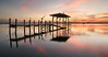 Disconnect. (Jill Bazeley) Tags: indian river lagoon intracoastal waterway dock pier boat house boathouse sunset sunrise heron pilings glassy glossy smooth reflection sony a6300 decay 1670mm zeiss abandoned florida great blue space coast brevard county merritt island