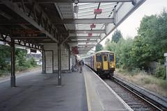 EMU (45)5703 at Motspur Park Station, 11 Sep 2003 (Ian D Nolan) Tags: railway motspurparkstation 35mm epsonperfectionv750scanner sr emu class455 5703 station