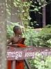 Young Monk (oxfordblues84) Tags: oat overseasadventuretravel cambodia kingdomofcambodia siemreapcambodia killingfields siemreap people person child boy monk buddhistmonk leaf leaves green orange robe watthmey
