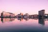 City in pink (Maria Eklind) Tags: ocean winter studiomalmö reflection spegling sweden outdoor water architecture malmö ice skånelän sverige se dusk boat city sea building sky skyline