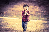 Kid Playing (Samrat_Banerjee) Tags: sun back lit young meadow blond alone dress farm cropland boy preschooler sunglass a7rii a7r2 mirrorless kid smiling happy playing playground carnival fair jeans sepia individuality confidence style grass joyful gmaster
