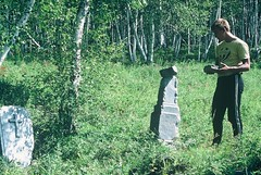 7k. Sasha wanders through some graves belonging to the Decembrists who were exiled to the Swamp region in eastern Siberia