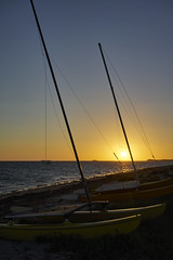 Catamarans at Rest (Stueyman) Tags: sony ilce alpha a7 a7ii za zeiss sunset rockingham perth wa westernaustralia australia sea ocean indianocean sky water coast boat catamaran 35mm