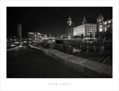Liver lights (Parallax Corporation) Tags: blackwhite liverbuilding liverpool beatlesmuseum wideangle monochrome sonya7rii zeissbatis18mm albertdock spotlights streetphotography lighttrails rivermersey