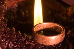 the one ring (mcschrot) Tags: johnrrtolkien thelordoftherings theonering oneringtorulethemall oneringtofindthem oneringtobringthemall inthedarknessbindthem oneringtorulethemalloneringtofindthemoneringtobringthemallandinthedarknessbindthem sonya6000 macromondays myfavouritenovelfiction ring thering flash flame candle middleearth thefellowshipofthering