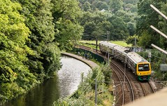 Spikes and spokes (Nodding Pig) Tags: edgbaston birmingham westmidlands england greatbritain uk 2017 railway train canal towpath cyclists worcesterbirminghamcanal class323 electric multipleunit 323240 hunslet londonmidland 201708197536101crop