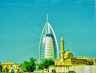 Urban view of Burj Al Arab and a mosque: Dubai (+3)