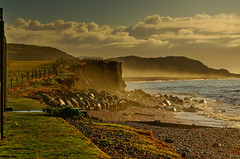 Just another day in paradise. (alex.vangroningen) Tags: beach sea hills mountains sky clouds fences rocks boulders northwales sand outdoors criccieth mist fog pebbles waves colors irishsea sun
