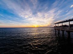 Pier Sunset (deepaqua) Tags: brooklyn lenstagger ocean sunset coneyisland cloud pier offseason atlanticocean goldenhour window