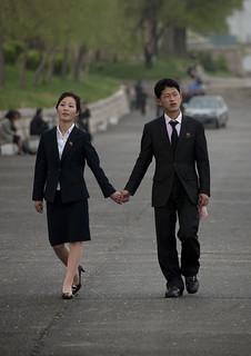 North Korean couple inlove walking hand in hand in the street, Pyongan Province, Pyongyang, North Korea