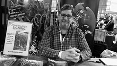 Capital Sci-Fi Con 2018 07 (byronv2) Tags: capitalscificon capitalscificon2018 cornexchange edinburgh edimbourg scotland convention sciencefiction comics scifi sciencefictionconvention comicsconvention cosplay costume blackwhite blackandwhite bw monochrome portrait man writer author judgedredd johnwagner 2000ad