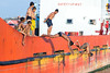 Sunday at Pelabuhan Paotere #7 (Xruuovtb) Tags: children jump harbour water ship color red deck canon eos600d efs1585 makassar sulawesi indonesia