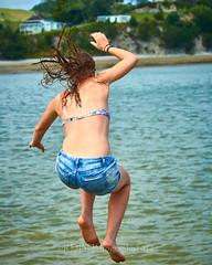 Pahi Beach 114 (C & R Driver-Burgess) Tags: teen young boy girls leap jump harbour wharf sea kaipara brother sister girlfriend nephew niece son daughter shorts halter top green blue clear sky sunny summer splash