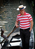 The Gondolier (manxmaid2000) Tags: gondola gondolier venice man canal water red thoughtful hat glasses spectacles striped stripes short relaxed job italy boat tourist tourism transport venezia italian boater straw work bored sad unhappy pocket pole cool styish smart