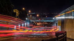 daly passage (pbo31) Tags: bayarea sanmateocounty nikon d810 transportation color evening january winter 2018 boury pbo31 motionblur movement night black dark dalycity bart station bus lightstream motion red passage transit muni stop roadway