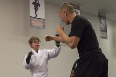 Dominating the Dojo (aaronrhawkins) Tags: karate studio bobbylawrence justus lawrence spar child boy lesson beginner fight martial art joshua black belt white provo utah discipline punch train aaronhawkins