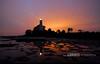 St. Marks Lighthouse: St. Marks, Florida (Lerro Photography) Tags: lighthouse stmarks florida fl sunset beams beacon sky water reflection