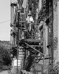 Fire escape (Arild Vågen) Tags: stairs brick building outdoor people fireescape blackandwhite monochrome bw toronto ontario niagarastreet canada construction perspective prime window facade architecture town city august 2017 nikon50mmf18