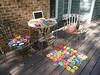 My outdoor office and an assortment of unfinished crochet projects (crochetbug13) Tags: crochetbug crochet crocheted crocheting crochetmotifs crochetsquares grannysquares rainbow pleinaircrochet multicolorcrochetmotifs crochetdress crochetblanket