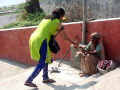 Helping The Needies At Mahadev Temple, Bharuch, Gujarat, India (Manoo Mistry) Tags: india bharuch mahadevtepmple temple hindu hindutemple hinduism nikon nikoncoolpixl23 gujarat people mandir candid candidshot begging begger