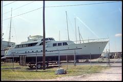 Bridget. (FreezerOfPhotons) Tags: himatic minoltahimatic7sii cosinamade kodakvision3 250d cinemafilm boating boatyard bigger than house