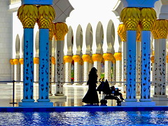 Sheikh Zayed Grand Mosque: Silhouettes (+3) (peggyhr) Tags: peggyhr sheikhzayedgrandmosque silhouettes mother stroller child columns arches pool reflections marble gold white black red green light shadows backlit sheikh zayed grand mosque dsc01357y abudhabi uae infinitexposurel1 super~sixbronze☆stage1☆ l1gestalt niceasitgets~level1 niceasitgets~level2 infinitexposurel2 thegalaxy thegalaxystars thegalaxylevel2 super~six☆stage2☆silver super~six☆stage3☆gold