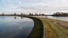 Walthamstow Wetlands (Francis Mansell) Tags: water reflection reservoir naturereserve londonwildlifetrust bank lake grass sky cloud london walthamstow walthamstowwetlands gate curve dam island