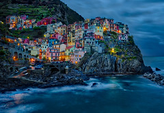 Recent Faves - Manarola, Cinque Terre (Stuck in Customs) Tags: italy stuckincustomscom treyratcliff manarola hdr hdrtutorial hdrphotography hdrphoto aurorahdr hasselblad x1d night europe long exposure houses lights sky waves town cliff colorful colourful moody storm dark nighttime mysterious glowing village cinque terre above dailyphoto daily outdoor outdoors color colour horizontal tower ocean bay gulf water east blue green brown red pink orange purple white black city may 2017
