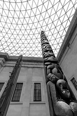 In the British Museum (Niaic) Tags: monochrome blackandwhite architecture museum history historic statue statues statuary totem totemic tall height high archaeology artefact learn learning past culture ethnography ethnographic london display contrast upward up towering built building repository knowledge cultural tourist
