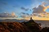 Llandwyn lighthouse at sunset (Rudi Verspoor) Tags: anglesey evening light lighthouse rocks sea sunset ocean seascape landscape clouds uk wales water nikon d5100