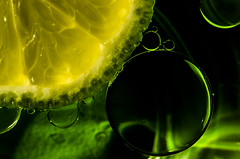 Lime Universe (Laurie4593) Tags: citrus macromondays abstractmacro lime oil water floating circles green macro spheres canonrebelt3i sigma70mmf28exdgmacro
