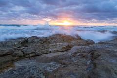 Waves Crashing over rocks at Sunrise (jimmypyne) Tags: australia queensland straddie sunrise seascape stormysea ocean rockpool rocks goldenhour orange long exposure crashing waves