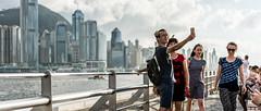 Hong Kong; Selfie Time (drasphotography) Tags: hongkong hong kong china streetphotography strasenfotografie people skyline couple selfie kowloon boy girl drasphotography streetshot nikkor2470mmf28 d810 travel travelphotography city cityscape urban