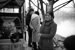 Old town residents: tour guide (sailwings) Tags: blackandwhite streetphotography street china