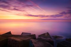 A graffiti in wonderland (Lluvia Fotografia) Tags: lights rocks seascape breakwater sunset sunshine beach water sky landscape sun sunrise longexposure graffiti reflection dawn bogatell barcelona