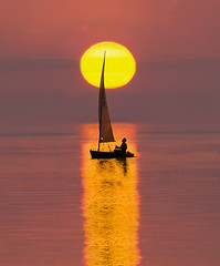 Caught in the Spotlight (adrians_art) Tags: people sailore sailing boats yachts craft vessels transport silhouettes shadows reflections sun sunset sea water wet sky clouds uk england whitstable red yellow gold amber light dark black white sport